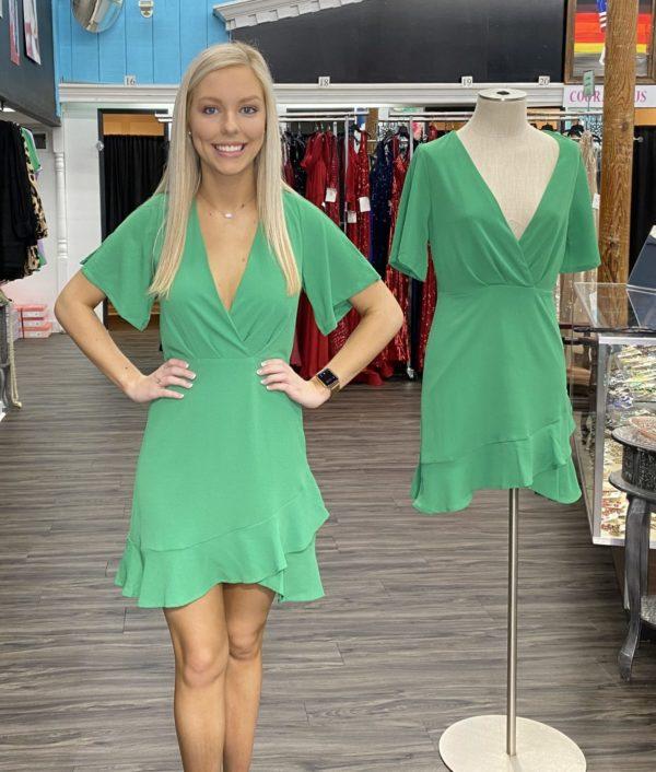 A short and flirty kelly green dress.